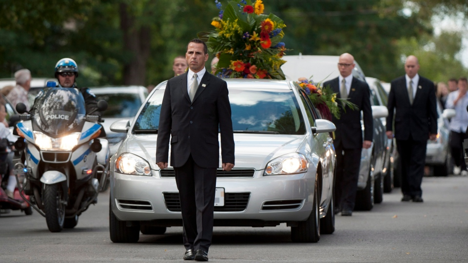The remains of Denis Blanchette arrives for his funeral in Montreal Monday, Sept. 10, 2012. (Graham Hughes / THE CANADIAN PRESS)