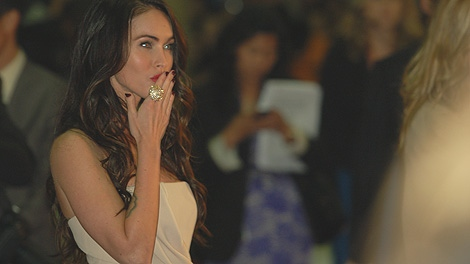 Yes, it's hard work, but Josh Visser took this photo of Megan Fox last night on the red carpet. No, he's not complaining.