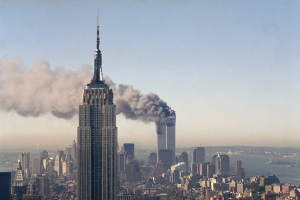 The twin towers of the World Trade Center burn behind the Empire State Building in New York, Sept. 11, 2001. (AP / Marty Lederhandler)
