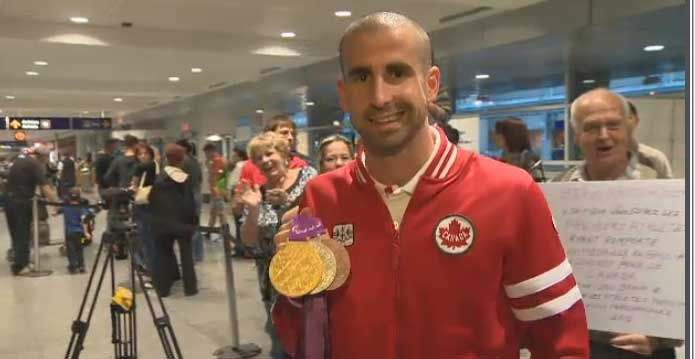 Paralympic swimmer Benoit Huot brought three medals home to Montreal