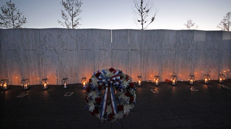 Forty luminaria are placed at the wall of names in memory of the 40 passengers and crew of United Flight 93 at the Flight 93 National Memorial at sunset on Monday, Sept. 10, 2012 in Shanksville, Pa. (AP Photo/Gene J. Puskar)