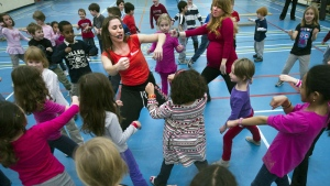 Michelle Hillier, right, founder of Canadian dance education company Fit2Dance, and dance instructor Amy Tepperman (left) hold a dance class with children from the Humewood Community School in Toronto on Wednesday, Feb. 29, 2012. (THE CANADIAN PRESS/Nathan Denette)