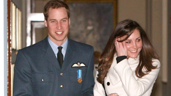Prince William and his girlfriend Kate Middleton walk in RAF Cranwell, England after William received his RAF wings from his father the Prince of Wales, Friday April 11, 2008. (AP / Michael Dunlea)