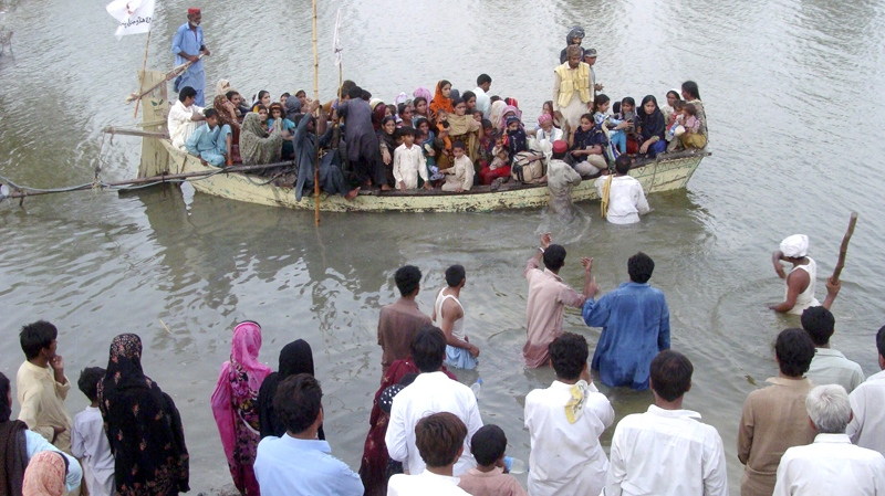 Pakistani flood survivors move to safer areas in Jaffarabad, Pakistan on Friday, Sept. 10, 2010. (AP / Fida Hussain)