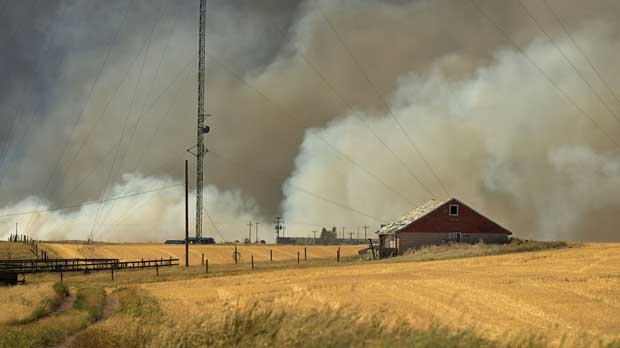 Smoke is seen over a home near Lethbridge.