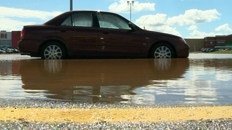A car sits in a flooded parking lot in Truro, N.S. on Tuesday, Sept. 11, 2012.