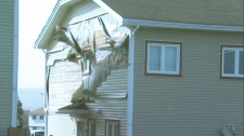 The side of a house is blown off in St. John's, N.L., on Tuesday, Sept. 11, 2012.