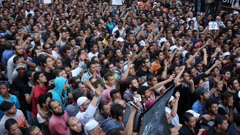 Protesters chant slogans outside the U.S. embassy in Cairo, Egypt on Tuesday, Sept. 11, 2012. (AP /Mohammed Abu Zaid)