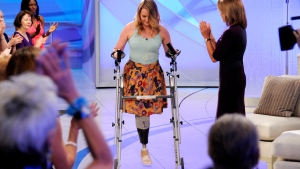 Host Katie Couric, right, applauds as Aimee Copeland, 24, of Snellville, Ga., who survived a rare fleshing-eating disease, arrives for an exclusive interview on the new daytime talk show 'Katie,' in New York on Tuesday, Sept. 11, 2012. (AP / Disney-ABC Domestic Television, Ida Mae Astute)