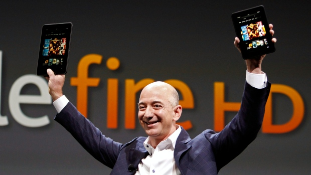 Jeff Bezos, CEO and founder of Amazon, holds the new Kindle Fire