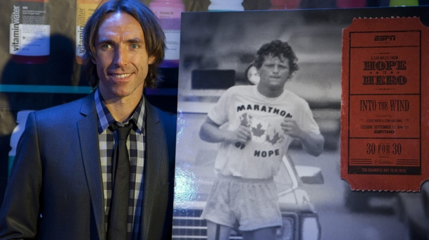 Steve Nash poses for photographers with a poster for the movie 'Into the Wind' a celebration of Terry Fox which Nash directed along with Ezra Holland in Toronto on Sunday, Sept 12, 2010. (Pawel Dwulit / THE CANADIAN PRESS)