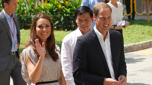 Prince William and his wife Kate, the Duchess of Cambridge, visit a local housing estate Wednesday, Sept. 12, 2012, in Singapore. (AP / Wong Maye-E)