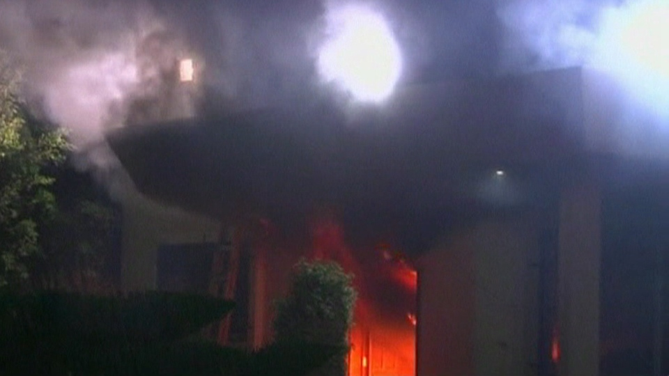 The U.S. consulate in the eastern city of Benghazi burns following an attack by angry protesters.