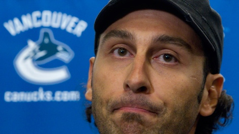 Vancouver Canucks goaltender Roberto Luongo pauses for a moment as he addresses a news conference at the Rogers Arena in Vancouver, Monday, Sept. 13, 2010. (CP/Jonathan Hayward)
