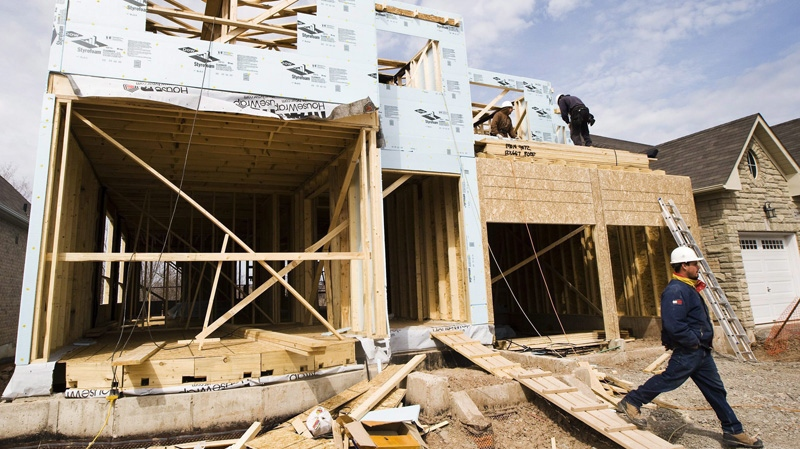 Construction workers build a new home in Oakville, Ont., on Tuesday, April 14, 2009. (Nathan Denette / THE CANADIAN PRESS)