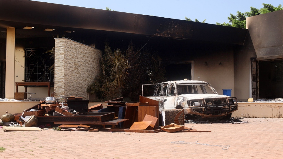 A burnt car is seen after an attack on the U.S. Consulate by protesters angry over a film that ridiculed Islam's Prophet Muhammad in Benghazi, Libya, Wednesday, Sept. 12, 2012.  (AP / Ibrahim Alaguri)