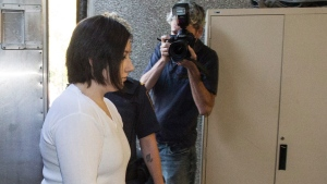 Terri-Lynne McClintic, convicted in the death of 8-year-old Woodstock, Ont., girl Victoria Stafford, is escorted into court in Kitchener, Ont., on Wednesday, Sept. 12, 2012 for her trial in an assault on another inmate while in prison. (Geoff Robins / THE CANADIAN PRESS)
