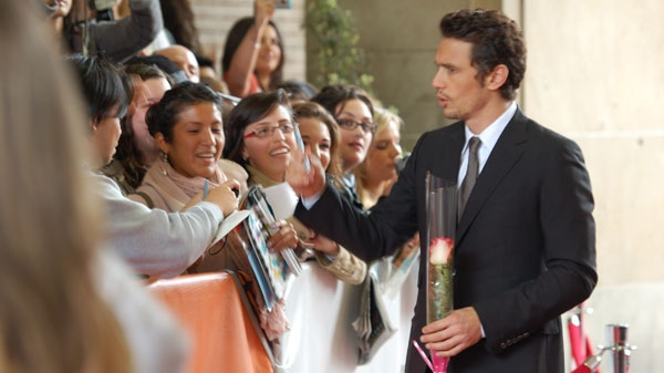 James Franco arrives for the premiere gala of '127 Hours' at the Toronto International Film Festival (Josh Visser / CTV.ca)