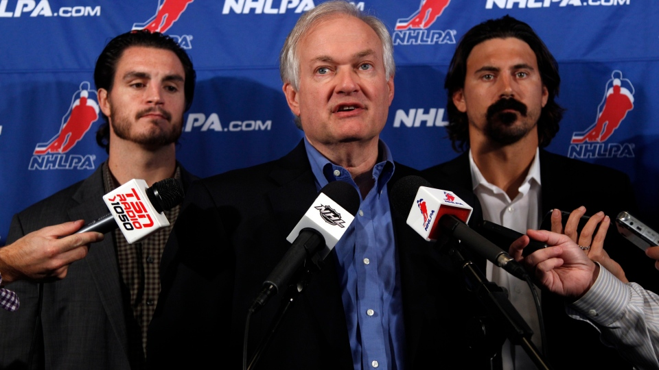 NHL Players Association executive director Donald Fehr, centre, is joined by players Kevin Westgath, right, and George Parros after meeting with NHL officials, in New York, Wednesday, Sept. 12, 2012. (AP / Mary Altaffer)