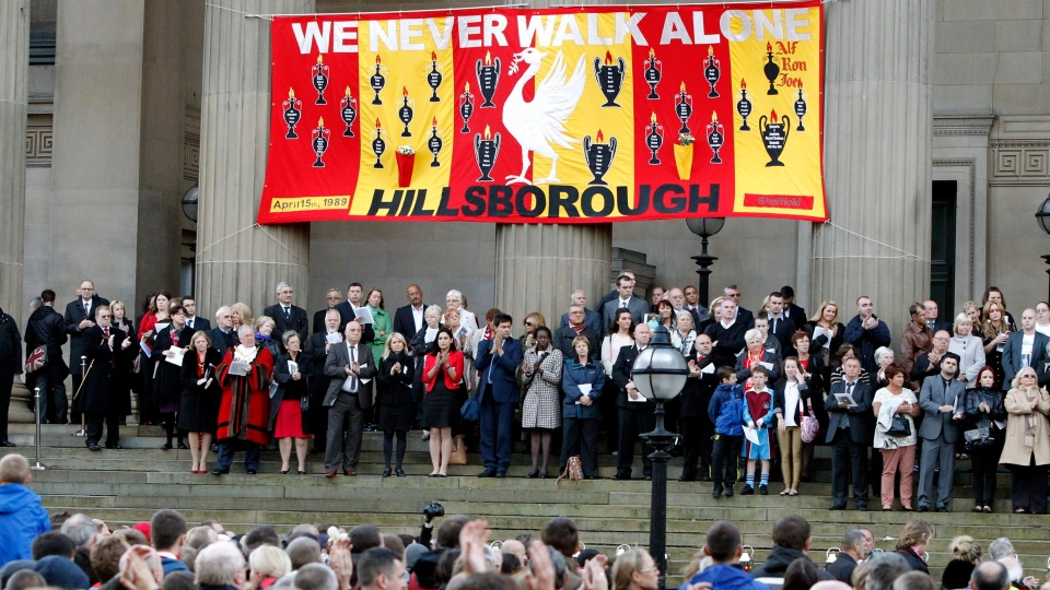 People gather at St. George's Place to attend a vigil in memory of the 96 victims of the Hillsborough stadium disaster in Liverpool, England, Sept. 12, 2012. (AP / PA, Peter Byrne)