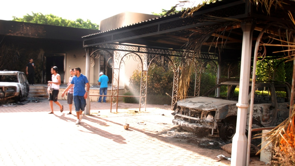 Libyans walk on the grounds of the gutted U.S. consulate in Benghazi, Libya, after an attack that killed four Americans, Wednesday, Sept. 12, 2012. (AP / Ibrahim Alaguri)