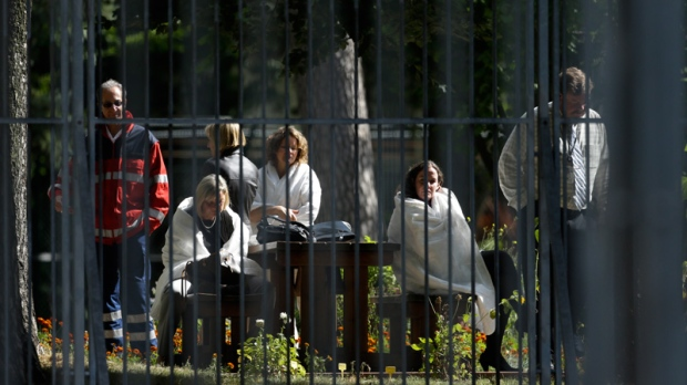 U.S. consulate staff wait in the courtyard of their Berlin mission on Sept. 13, 2012.