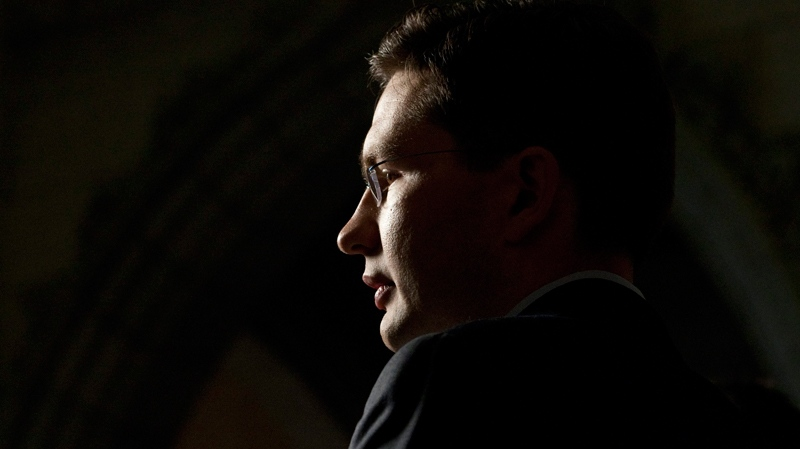 Pierre Poilievre, parliamentary secretary to the prime minister, speaks with the media about the gun registry in the foyer of the House of Commons on Parliament Hill in Ottawa, Tuesday, Sept. 14, 2010. (Adrian Wyld / THE CANADIAN PRESS)