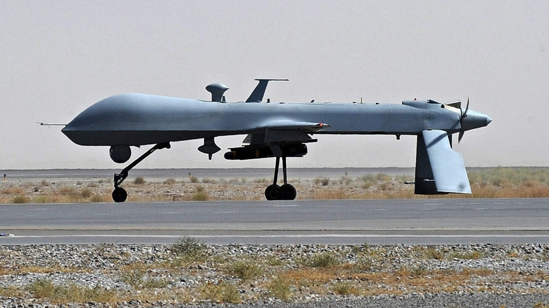 A U.S. Predator unmanned drone armed with a missile stands on the tarmac ofKandahar Airfield, Sunday, June 13, 2010. (AP / Massoud Hossaini)