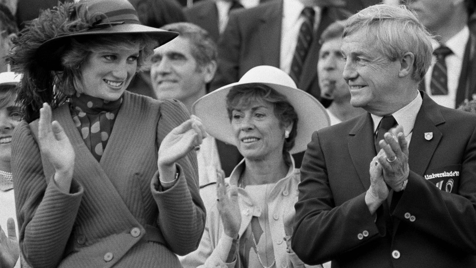 Alberta Premier Peter Lougheed looks over at Princess Diana as she claps for the Canadian team as they pass the Royal box during the opening ceremonies of the Universiade, July 1, 1983. (Andy Clark / THE CANADIAN PRESS)