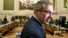 Minister of Industry Tony Clement takes his seat as he waits to appear before the Standing Committee on National Defence on Parliament Hill in Ottawa, Wednesday Sept. 15, 2010. (Adrian Wyld / THE CANADIAN PRESS)