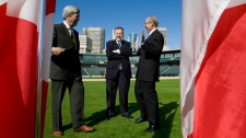 Luc Lavoie, left, head of development for Sun TV News jokes with Winnipeg's Mayor Sam Katz, right, and radio host Charles Adler prior to a press conference on a baseball field in Winnipeg, Wednesday, Sept. 15, 2010. Lavoie announced that outspoken radio host Adler will anchor a prime time TV show when Sun TV News launches in 2011. (John Woods / THE CANADIAN PRESS)