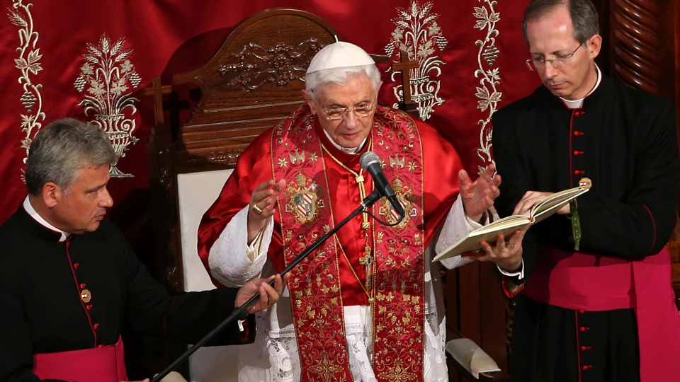 Pope Benedict XVI, centre, delivers his blessing before the signing of the post-Synodal Apostolic Exhortation of the special assembly for the Middle East of the Synod of Bishops, at St. Paul's Basilica, in Harissa east of Beirut, Lebanon, Friday, Sept. 14, 2012. (AP / Hussein Malla)