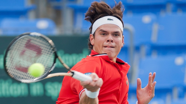 Milos Raonic from Canada returns the ball to Nikala Scholtz from South Africa during Davis Cup tenni