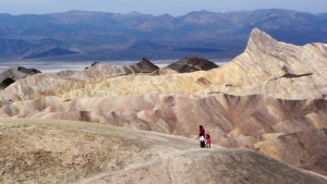 A tourist walks along a ridge at Death Valley National Park, Calif., April 11, 2010. (AP / Brian Melley)