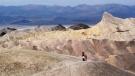 A tourist walks along a ridge at Death Valley National Park, Calif., April 11, 2010. (AP / Brian Melley)