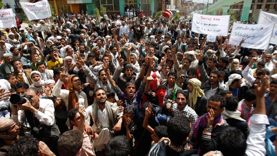 Protesters gather near the U.S. Embassy in Sanaa, Yemen, Friday, Sept. 14, 2012, as part of widespread anger across the Muslim world about a film ridiculing Islam's Prophet Muhammad. (AP/Hani Mohammed)