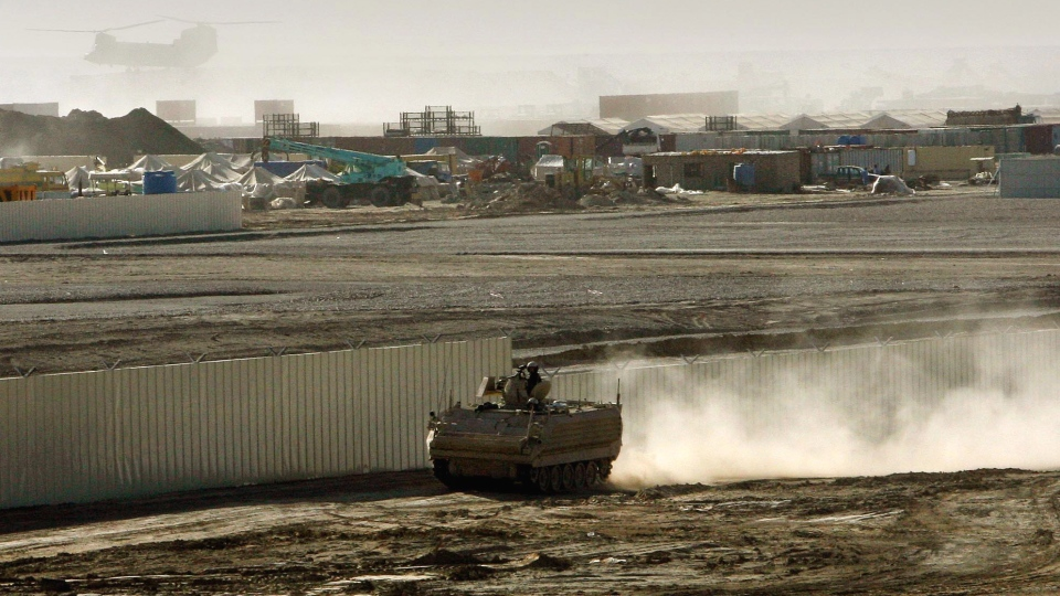 A British armored vehicle patrols on the periphery of Camp Bastion in southern Afghanistan, in this Wednesday, Jan. 10, 2007 file photo. (AP / Manish Swarup)