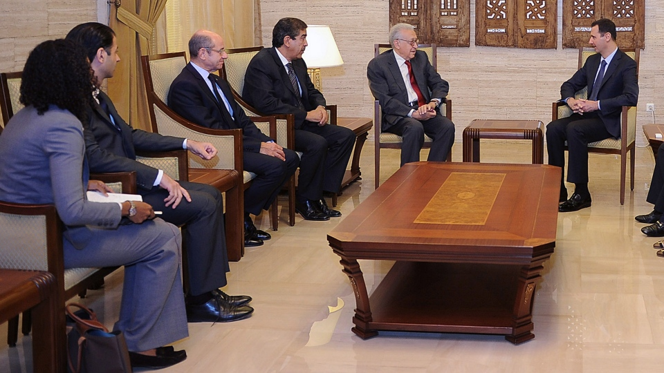 In this photo released by the Syrian official news agency SANA, Syrian President Bashar Assad, right, meets with the U.N.-Arab League envoy Lakhdar Brahimi, second right, in Damascus, Syria, Saturday Sept. 15, 2012. (AP / SANA)