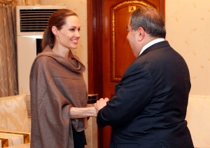 United Nations High Commissioner for Refugees (UNHCR) special envoy Angelina Jolie, left, shakes hands with Iraqi Foreign Minister Hoshyar Zebari in Baghdad, Iraq on Sept. 15. Jolie said Friday that with winter approaching, she is concerned about the plight of hundreds of thousands of Syrians forced to flee their homes.(AP/Karim Kadim)