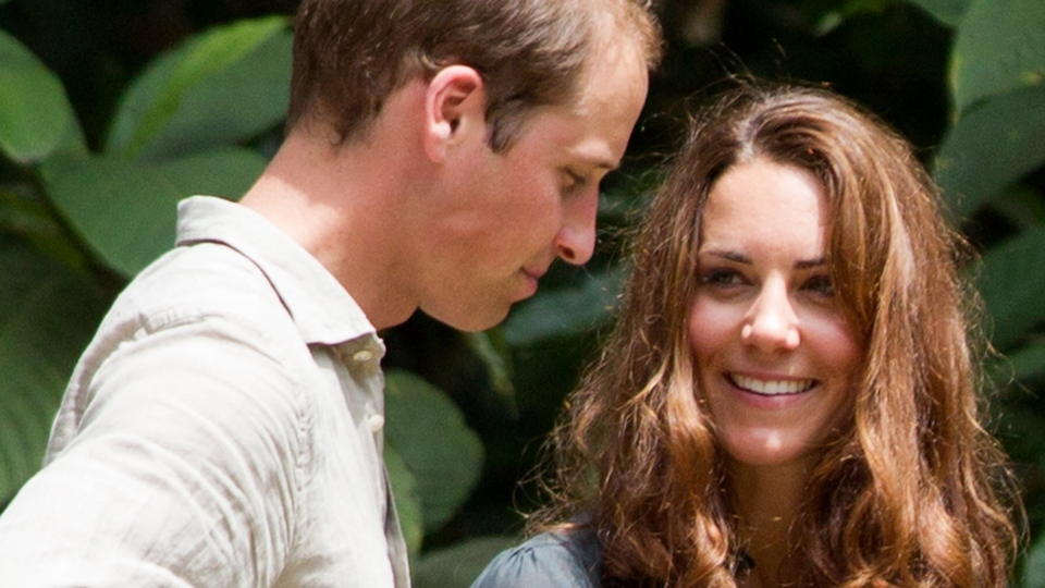 Prince William, left, and Kate, the Duchess of Cambridge speak to each other during their visit at the Borneo Rainforest Lodge in Danum Valley, some 70 kilometres west of Lahad Datu, on the island of Borneo on Saturday, Sept. 15, 2012. (AP /Mohd Rasfan)