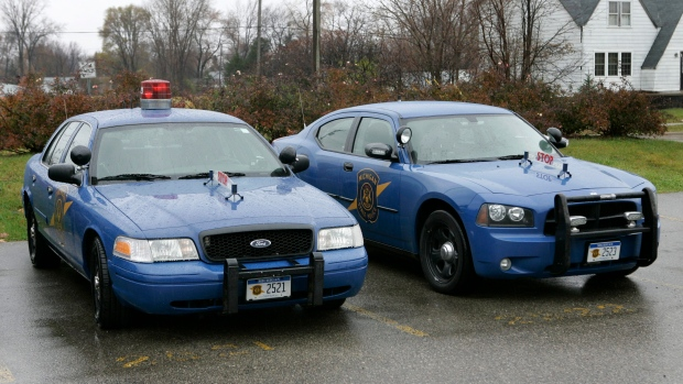 A Michigan State Police Dodge Charge, right, is shown with a Ford Crown Victoria in Taylor, Mich., W
