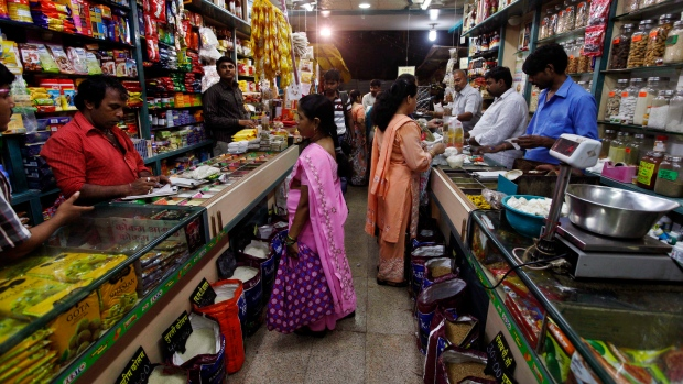 Indian people shop at a store in Mumbai, India, Friday, Sept. 14, 2012. India agreed Friday to open