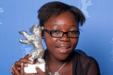 Congolese actress Rachel Mwanza reacts after she has been awarded with the Silver Bear as best actre