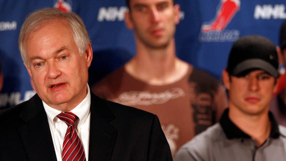 NHL Players Association executive director Donald Fehr, left, is joined by Boston Bruins' Zdeno Chara, centre, and Pittsburgh Penguins' Sidney Crosby as he speaks to reporters during a news conference in New York, Thursday, Sept. 13, 2012. (AP / Mary Altaffer)