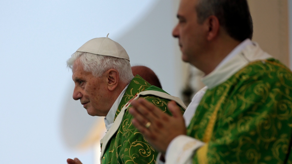 Pope Benedict XVI prays during a mass on the waterfront in Beirut, Lebanon, Sunday, Sept. 16, 2012. (AP /Alessandra Tarantino)