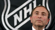 NHL hockey commissioner Gary Bettman listens as he meets with reporters after a meeting with team owners, in New York on Sept. 13. The NHL locked out its players at midnight Saturday, becoming the third major sports league to impose a work stoppage in the last 18 months. The action also marks the fourth shutdown for the NHL since 1992, including a year-long dispute that forced the cancellation of the entire 2004-05 season when the league held out for a salary cap. (Associated Press File Photo / Mary Altaffer)