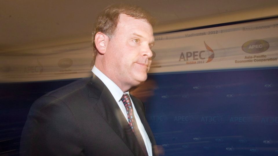 Canadian Minister of Foreign Affairs John Baird leaves the room speaking in Vladivostok, Russia, Friday September 7, 2012. (Adrian Wyld / The Canadian Press)