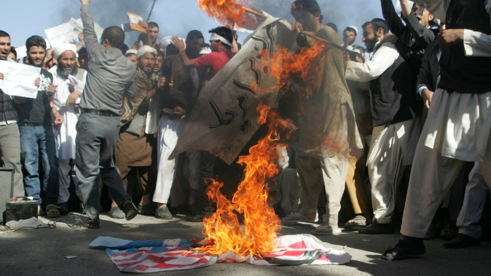 Afghans burn the U.S. flag in Herat, west of Kabul, Afghanistan, Sunday, Sept. 16, 2012, during a protest against an Internet video mocking the Prophet Muhammad that many fear could further aggravate Afghan-U.S. relations. (AP / Hoshang Hashimi)