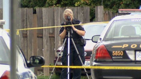Police investigate an early-morning shooting death in Abbotsford, B.C. Sept. 16, 2010. (CTV)