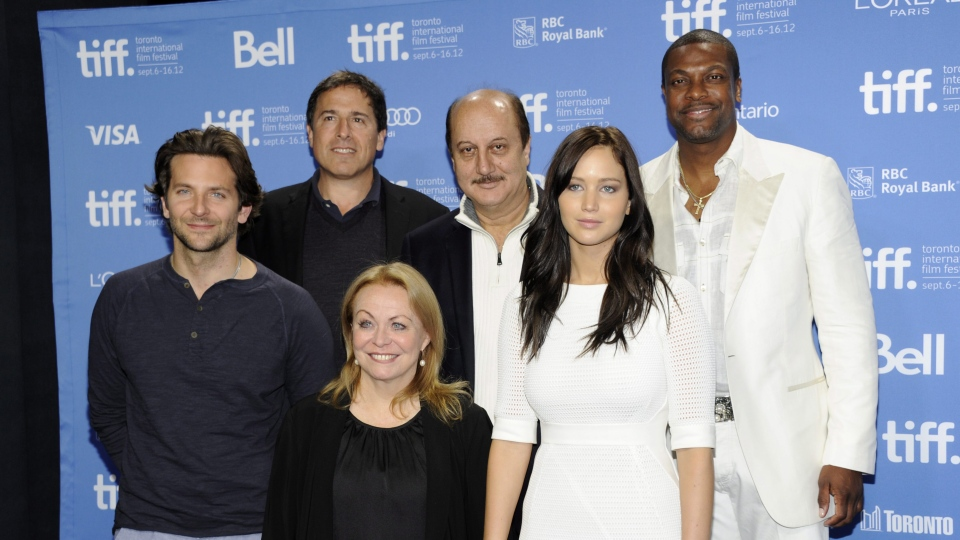 "From left, actor Bradley Cooper, director David O. Russell, actress Jacki Weaver, actor Anupam Kher, actress Jennifer Lawrence, and actor Chris Tucker participate in a photo call and press conference for the film ""Silver Linings Playbook"" at TIFF Bell Lightbox during the Toronto International Film Festival on Sunday Sept. 9, 2012 in Toronto. (Photo by Evan Agostini/Invision/AP)"